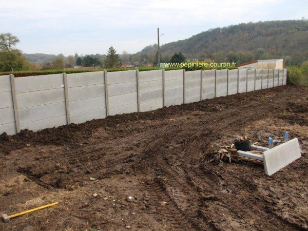 Une autre clôture en panneaux béton